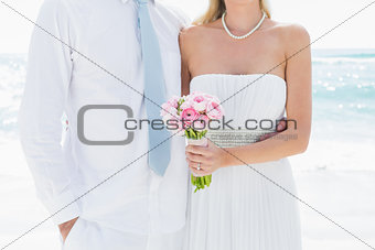 Couple standing together on their wedding day