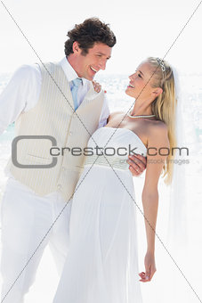 Groom dipping his happy new wife while dancing