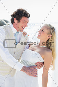 Groom dipping his smiling new wife while dancing