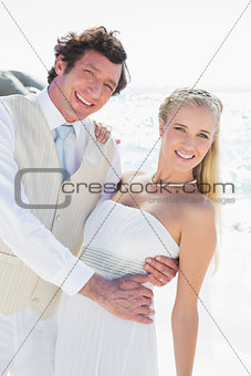 Groom dipping his smiling new wife while dancing looking at camera