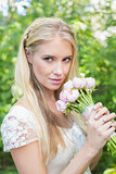 Blonde bride holding pink bouquet