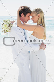 Romantic couple hugging each other on their wedding day
