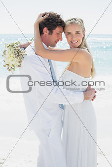Couple hugging each other on their wedding day