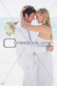 Couple embracing each other on their wedding day