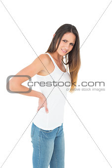 Portrait of a young woman suffering from back pain