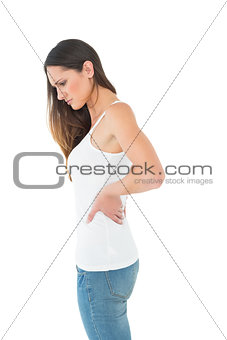 Casual thoughtful woman suffering from back pain