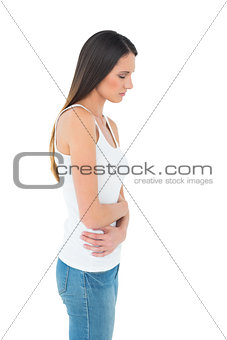 Casual woman with stomach pain and headache