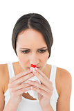 Brunette woman having a nose bleed