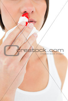 Close-up mid section of a woman with bleeding nose