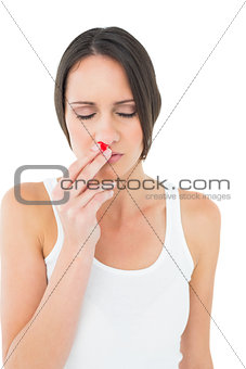 Casual young woman with bleeding nose