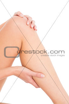 Close-up mid section of a woman with leg pain