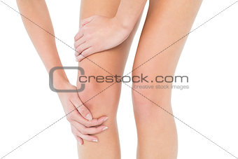 Close-up mid section of a woman with knee pain
