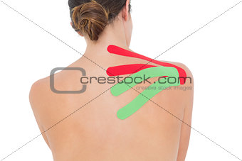 Topless woman with red and green strips on shoulder