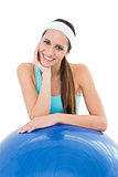 Smiling fit young woman with fitness ball