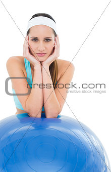 Fit young woman with fitness ball