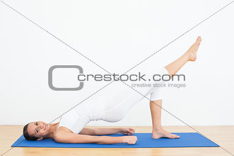 Fit woman doing pilate exercises in the fitness studio