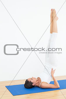 Fit woman stretching body in the fitness studio
