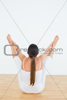 Toned woman doing the balancing bear posture