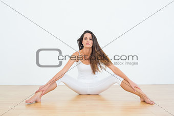 Slim woman with long hair in fitness studio