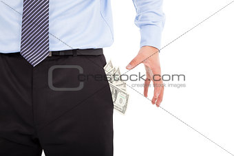 Business man grabbing  pocket money over white