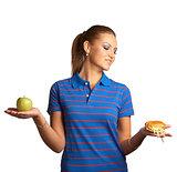 Woman with hamburger and apple
