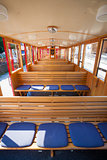 Steam train inside car passenger benches