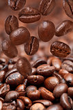 many falling beans and dark roasted coffee