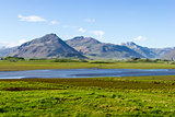 Beautiful lake against mountain background, Iceland, good summer