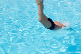 Activities on the pool. Boy diving in swimming pool