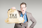 Accountant holding large tax return refund