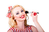 Cosmetics pin-up model applying blusher makeup