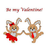 "A couple of funny cartoon rabbits with text ""Be my Valentine"". A"