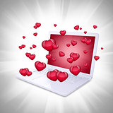Red hearts fly out of the laptop