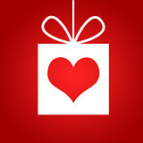 Red heart in gift. Red background