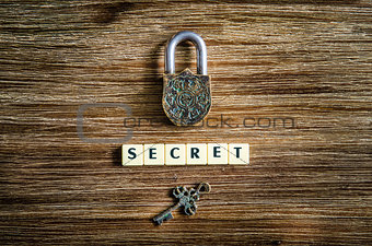 Old vintage padlock and key with secret sign