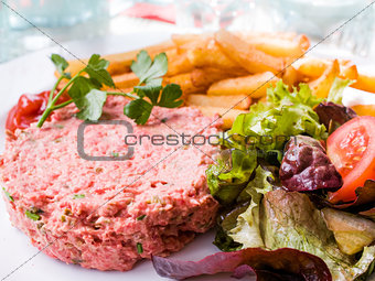 classic steak tartare on white plate