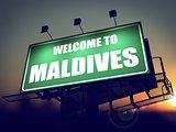 Billboard Welcome to Maldives at Sunrise.