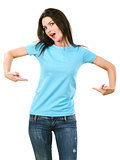 Brunette pointing at her blank light blue shirt