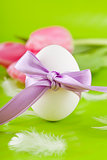 traditional easter egg decoration with tulips and ribbon