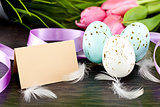 traditional easter egg decoration with tulips and ribbo
