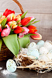 festive traditional easter egg decoration ribbon and tulips