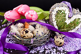 pink tulips and brown eggs with purple ribbon easter decoration