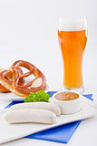 weisswurst white sausages and sweet mustard with pretzel