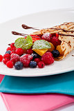 fresh tasty homemade crepe pancake and fruits