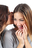 Two gossip teenager girls telling a secret