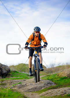 Cyclist Riding the Bike on the Beautiful Mountain Trail