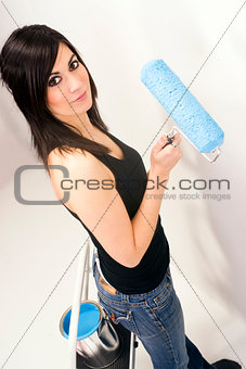 Attractive Handy Woman Using Paint Roller Blue Paint Project