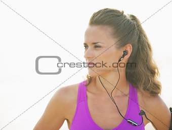 Portrait of fitness young woman outdoors