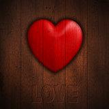Grunge heart on wood background