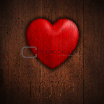 Grunge heart on wood background